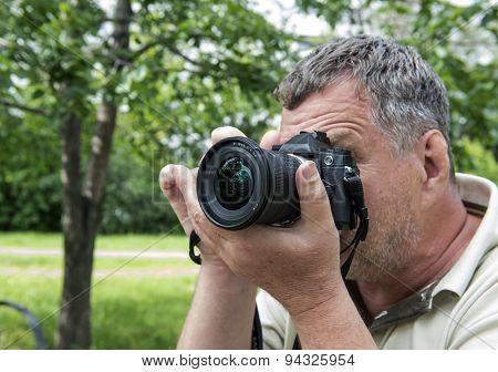 Photographer using a dslr camera
