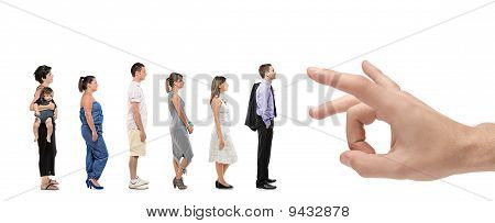 Full Length Portrait Of Men And Women Standing Together In A Line With A Hand About To Push Them