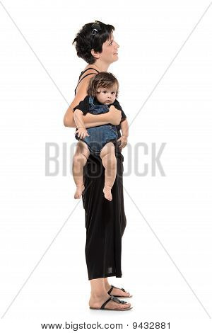Full Length Portrait Of Woman With Her Baby Boy Waiting In Line