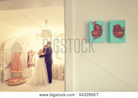 Bride and groom embracing in beautiful house