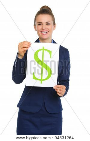 Happy Businesswoman Holding Up Sheet Of Paper With Dollar Sign