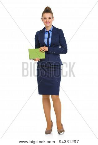 Elegant Business Woman Standing And Holding Notebook