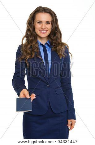 Closeup Of Businesswoman In Suit Handing Over Blue Passport