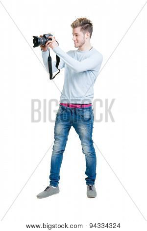 Young photographer holding a dslr photo camera isolated on white