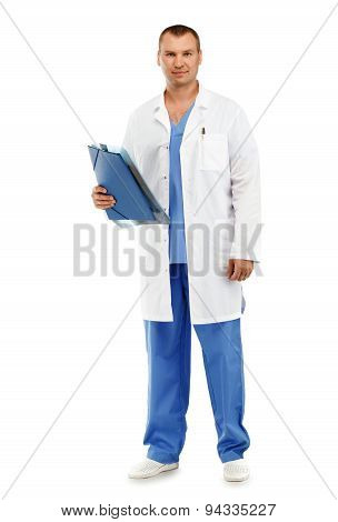 Full-length Portrait Of A Young Male Doctor In A White Coat And Blue Scrubs