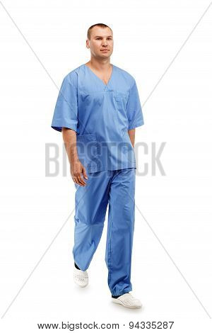 Full Length Portrait Of A Young Male Doctor In A Medical Surgical Blue Uniform In Motion