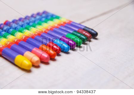 wax crayons on wood table
