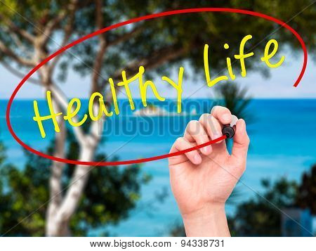 Man Hand writing Healthy Life black marker on visual screen.