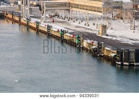 Pier Of The Ferry Port At Winter Time