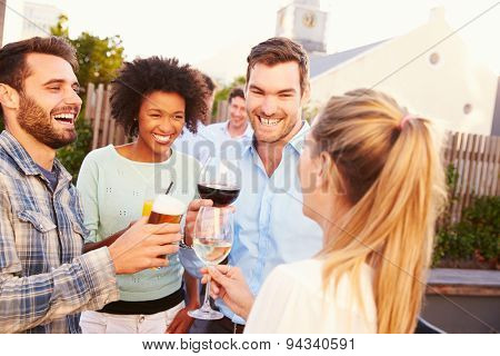 Group of friends drinking at a rooftop bar