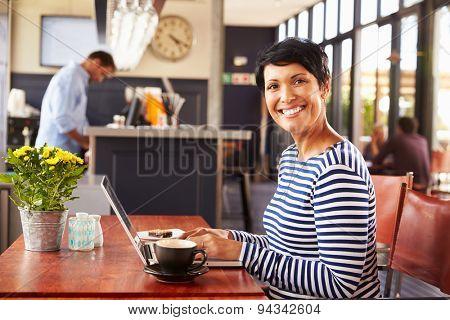 Woman using computer, portrait