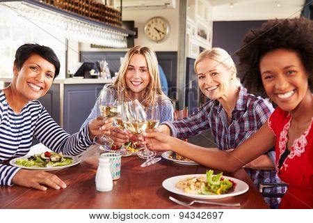Female friends eating at a restaurant, portrait