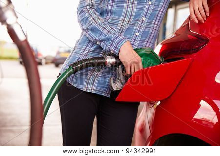 Refuelling a car at a petrol station, close up