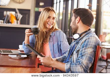 Young man and woman meeting at a coffee shop