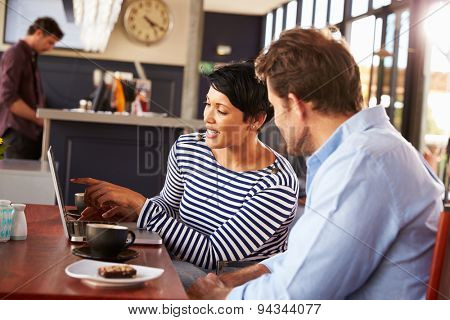 Man and woman meeting over coffee in a restaurant