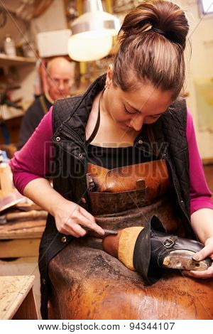 Young shoemaker working in a workshop