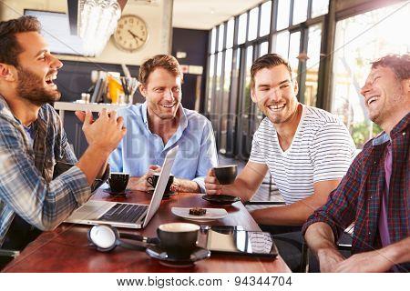 Men having fun at a coffee shop