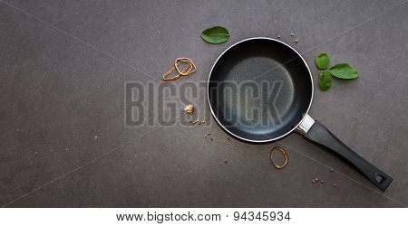 Pan With Handle On Black Background.