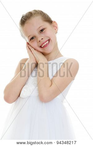 Girl in a white summer dress, close-up
