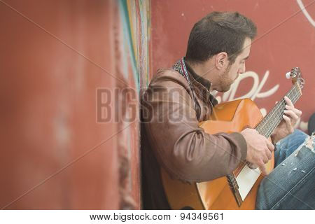 man with guitar. urban style