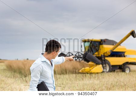 Businessman With Combine Harvester