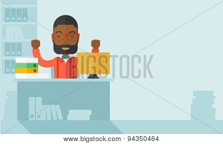 A very happy black businessman sitting while raising his both hand finished his work with laptop and paper works on time inside his office. Achievement concept. A Contemporary style with pastel