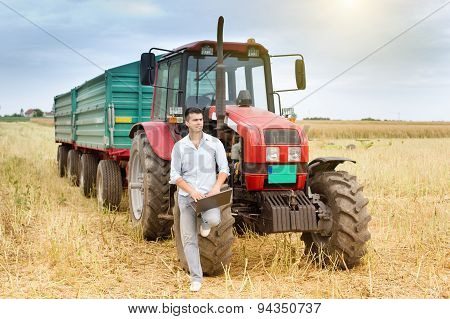 Businessman With Laptop And Tractor