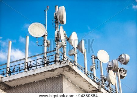 Telecomunication dish and mobile antenas on roof in Brazil. America.