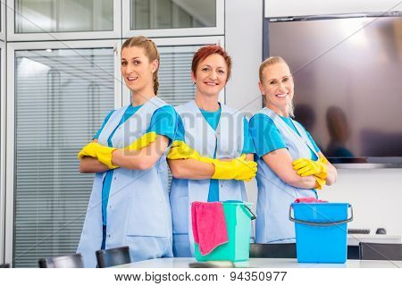 Cleaning brigade working in office