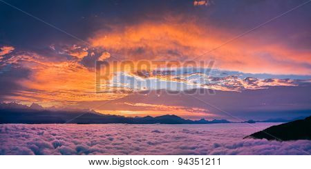 Bright and colorful sunset over the sea of clouds.