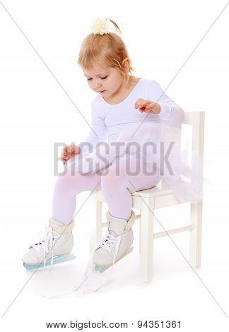 Child skater wears on his feet skates