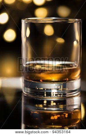 Whiskey glass on the tray. Shallow depth of field.