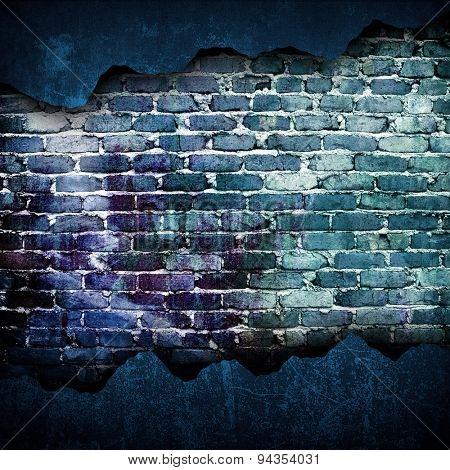 crack brick wall with graffiti