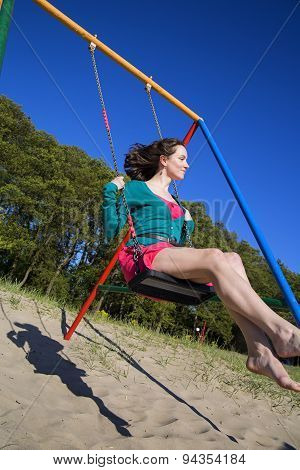 Woman On The Swings With Happy Smile