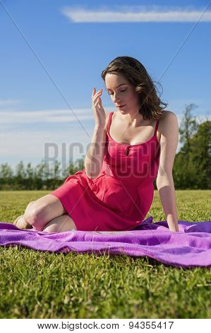 The Cute Brunette Lady On The Meadow