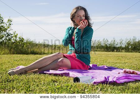 Healthy Lifestyle Female Sitting On The Grass