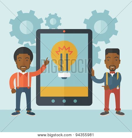 Two african businessmen standing while holding a big screen tablet with bulb icon a computer tablet perspective view strategy marketing. Business concept. A Contemporary style with pastel palette