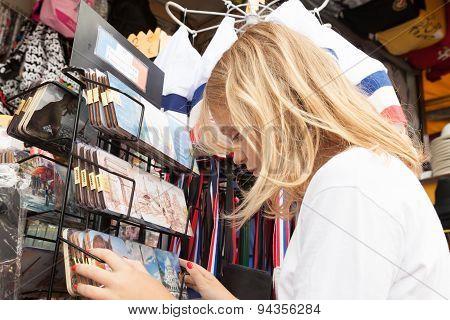 Little Blond Girl Is Choosing Souvenirs, Paris