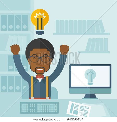 A young black guy is happy raising his two hands getting an idea through computer internet inside his office. Successful concept. A Contemporary style with pastel palette, soft blue tinted background