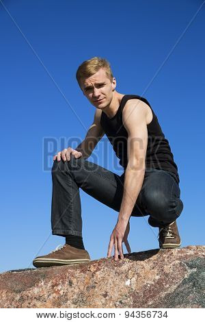 Attractive Young Man Posing On The Rock