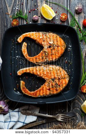 Grilled red fish steaks salmon on the grill pan