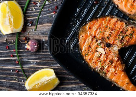 Grilled red fish steak salmon on the grill pan