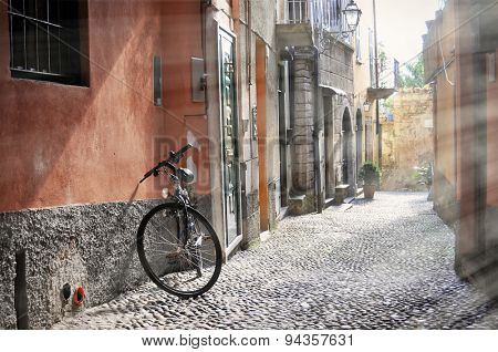 Bicycle on the narrow street of Bellagio town at the famous Italian lake Como