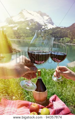 Wine and fruits served at a picnic in Alpine meadow. Switzerland