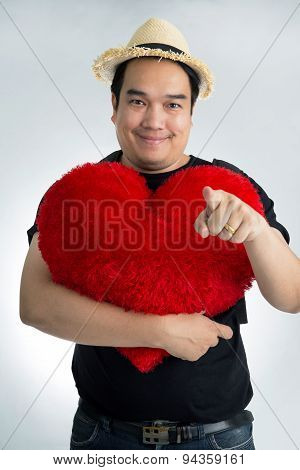 Happy Asian Man Hold Big Red Heart