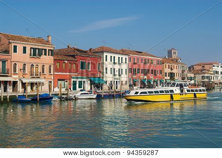 Public transportation boat passes by the Grand canal in Murano, Italy.