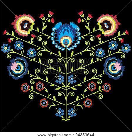 Polish folk floral pattern in heart shape on black background