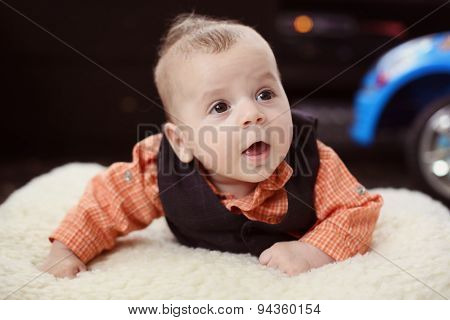 Cute Baby Boy On White Blanket