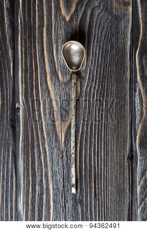 Vintage silver spoon on rustic wooden background