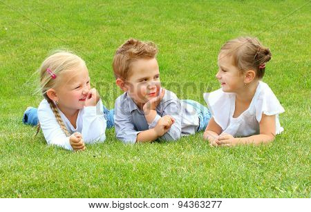 Three little friends have a fun on meadows. Happy holidays concept.